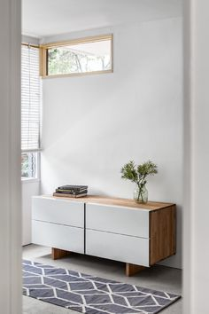 Organize your wardrobe in the expertly crafted LAXseries Low Boy Dresser. Four aluminum-wrapped solid wood drawers with side finger pulls and an under-mounted door slide give this piece a clean minimalist look.