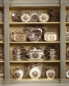 Love the faux bois piece in the center and the stacked cups.