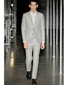 Patrik Ervell - Suits that Shine:  Shiny suits are a little bit of a nod to the Rat Pack but they're not overly retro looking.     Read More http://www.gq.com/style/wear-it-now/201203/jim-moore-spring-trend-report-photos#ixzz1wTasPqNt