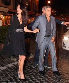 In love: Amal and George Clooney headed for a date night at Dal Bolognese in Rome on Satur...