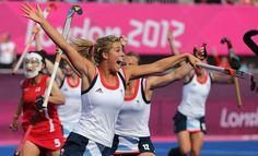 Britain's Georgi Twigg celebrates scoring a goal against South Korea with her teammates during a women's hockey preliminary round match at the 2012 Summer Olympics, Tuesday, July 31, 2012, in London.