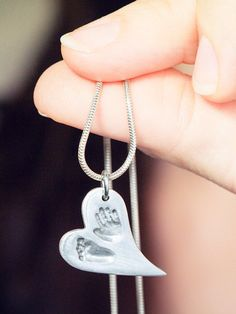 Perfect for proud moms: baby's actual hand and footprint in a heart shaped necklace pendant - custom-made with love <3