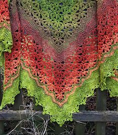 Strawberry Fields is a top down rectangular triangle shawl, featuring intriguing flower lace sections, framed by chevron sections.