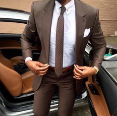 Lovely brown suit / white shirt / brown tie with white dots.