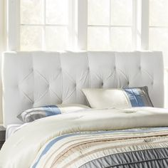 Pairing a streamlined design and button-tufted upholstery, this chic headboard makes a versatile canvas for experimenting with new looks. Let its crisp hue balance bright bedding and playful pillows, top it with a jewel-toned comforter to bring out its regal side, or dress it in a crisp white duvet cover for resort-worthy polish.