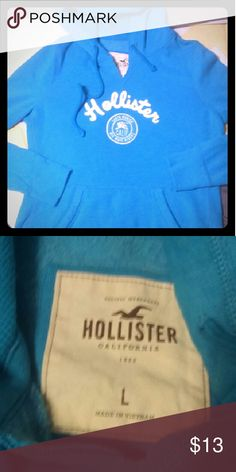 Hollister Hoodie! Blue Never before have I wore this! Size Large, but runs small. So I would say it could fit Small or Medium Excellent condition! Very Soft!  Has tiny pen mark but not noticeable and I'm not sure how it got there. That's why the price is so low Hollister Tops Sweatshirts & Hoodies