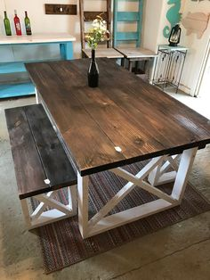 Farmhouse Table With Benches with Dark Walnut Top and Weathered White Base and Cross Brace Design Rustic Farmhouse Table With Benches with Dark Walnut Top andThe Dark The Dark may refer to: Decor, Rustic Furniture, Bench Table, Diy Home Decor, Rustic Farmhouse Table, Rustic Kitchen Tables, Kitchen Table Bench, Home Decor, Dining Room Table