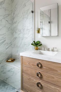 Restoration Hardware Maison Single Vanity brings a stunning contrast to marble surroundings seen on shower walls and shower bench.