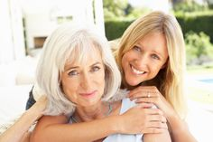 Portrait Of Mother And Adult Daughter Relaxing On Sofa - stock photo Mother Daughter Pictures, The Long Goodbye, Coping With Loss, Signs Of Depression, Spa Packages, Hand Therapy, Senior Home Care, Spa Deals, Parenting Fail