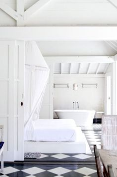 Clean white room with bold geometric floor.