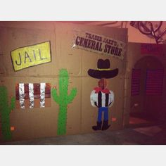 Cowboy themed party - cut out easy shapes to make the scenery for the kids. Painted with acrylic paint all free-hand. Box was from a furniture delivery. Aluminum is wrapped around the jail bars.