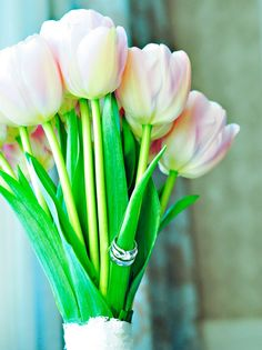 Pink French Tulip Bouquet with wedding rings on the stem :)  I love tulips in bouquets, table decor and pretty much everywhere. In South Africa tulips are found predominantly in April, one of our biggest wedding months locally. Visit my website and www.fb.com/labolaweddings for more info and ideas