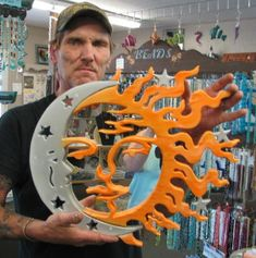 mirror with scroll saw cutout design of sun & moon (and Mr. Grumpy that day)