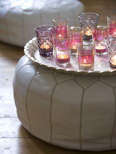 Tea lights on a tray on a pouf