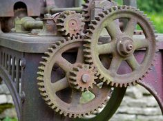 https://flic.kr/p/8rqmNG | Gears | Gearing on a rusting old machine we noticed in the yard of a church in Castleton. My guess is that it was for grinding lead ore. It was manufactured in Manchester.