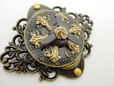 LOVE.....what awesome things she does to make the findings her OWN!  http://www.etsy.com/listing/90732284/steampunk-clockworks-brooch-pin-with   From Brassy Steamington....a few little doodads from bsueboutiques.com