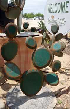 These cactus are made out of reclaimed metal from old dumpsters, they are part of the RestoreDecor line, available at Garden-Ville locations. #RestoreDecor, #cactus