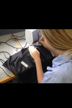 When sewing my inner pocket to the lining of my bag, I had to use marking tape to 'pin' the fabric onto my linning because using pins would have left holes in the leather pocket whic I did not want. When sewing I always made sure my hair was out if my face