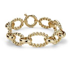 Make a bold statement with this Italian crafted chunky braided bracelet forged in 14k yellow gold.