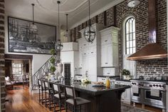 Stunning kitchen with elevated ceilings, exposed brick wall and a metallic stove with a dramatic copper hood in this pre-Civil War home in Charleston, SC. [1500 × 1000] : RoomPorn