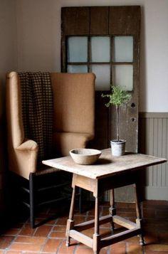 FARMHOUSE – INTERIOR – early american decor inside this vintage farmhouse seems perfect, like this cozy corner.