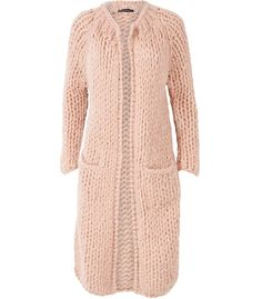 Sometimes you just want to curl up in an oversized chunky knit. This cardigan is an essential piece for this autumn. The chunky hand-knitted cardigan has two pockets and is available in two soft shades.
