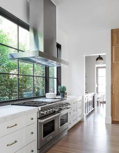 Kitchen hood in front of windows