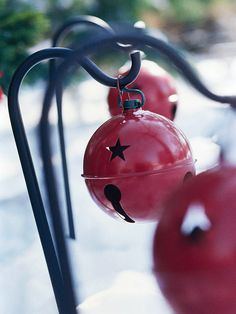 Outdoor Decoration    Line up simple shepherd's hooks with oversize red jingle bells along the sidewalk or driveway to add a punch of color to a wintry landscape.