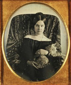 daguerreotype of a lady and her cat