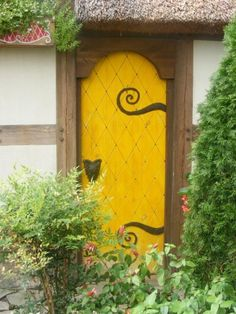 Cottage door- add fairy tale elements to garden cottage- this hardware and a witch weathervane