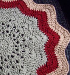 This Gentle Waves Round Ripple Crochet Afghan is aptly named since the pretty edge is gently waved and scalloped. It's a fun break from your usual square a rectangle afghans, and the easy afghan crochet pattern is free.