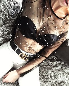 Black and white style: Gucci belt with white jeans and black top with pearls