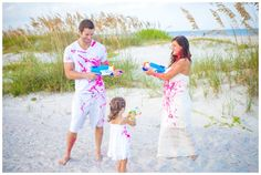 St. Augustine Family Photographer// Creative Gender Reveal/ Water Gun Gender Reveal