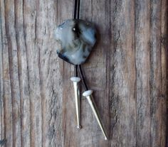 I made this bolo with a dramatic blue black beach agate found on the central Oregon coast. I drilled a hole throngh it for the leather cord.