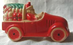 Celluloid or Viscaloid Santa in Roadster with Toys and Christmas Tree Decoration.