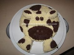 Homemade Cow Birthday Cake: .  I made a chocolate cake using two 9 round cake pans.  One