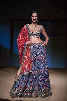 Ashima Leena blue multicolored ornate lehnga with low cut blouse. More here: http://www.indianweddingsite.com/bmw-india-bridal-fashion-week-ibfw-2014-ashima-leena/