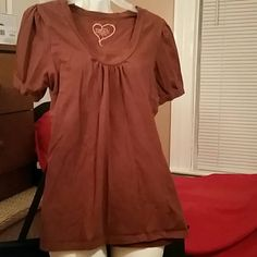 Large Brown T-shirt- Rue 21 A nice casual brown tee that is a good addition to jeans skirt or jeans. Rue 21 Tops Tees - Short Sleeve