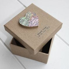 Beautiful, personalised keepsake box.Please Note We use a collection of vintage maps to source our locations and our atlases often pre-date 1960s so it is near impossible to source images of roads, landmarks or specific buildings etc. Generally, we ask that you choose a town (UK) or city (worldwide) so we can successfully find your location. Please provide as much information as possible about your chosen location. Our international maps are often less detailed and small islands (such as the Seychelles, Maldives etc) are unlikely to be shown in detail. If we are unable to show your location in detail, we may show the relevant area. Unfortunately, we cannot check for specific locations prior to purchase.Away from home? This beautiful vintage map keepsake box is the perfect way to store the things that remind you of home. Its compact size means it's handy to take with you when exploring the world around. And if you're not too bothered about missing home, why not use it to store your travel keepsakes so you can revisit your adventures anytime you wish.card, wood, paper9cm x 8 cm Wedding Favours, Wedding Gifts, Party Favours, Favors, Wedding Ideas, Origami 2d, International Map, Heart Location, Party Giveaways