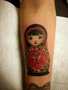 http://tattoomagz.com/russian-doll-tattoos/russian-doll-tattoo-matryoshka-with-rose/