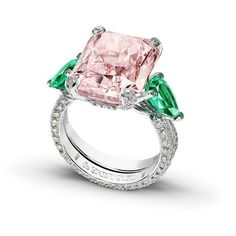 Gorgeous white gold ring featuring an outstanding 12.18 carats fancy and girly vivid pink diamond and two 1.82-carat pear cut emeralds by @degrisogono