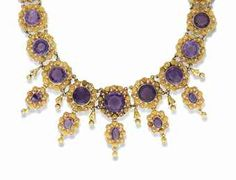 A MID 19TH CENTURY GOLD AND AMETHYST NECKLACE. Composed of a series of graduated circular-cut amethysts each within a bead and wirework surround, suspending five similarly-set oval drops. circa 1840. Linley Hall, Shropshire: Property from The Collection of The Late Sir Jasper & Lady More.