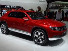 VW CrossCoupe TDI concept (photos)  Volkswagen mixed technologies and styles with its CrossCoupe TDI. This concept is a diesel hybrid plug-in, which could make it a fuel economy winner. Its high stance earns it the crossover part of its name, but four doors and a rear hatch call into doubt its coupe-ness.