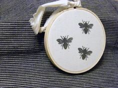 Bee embroidery hoop. I think that screen printed dogs on linen fabric, displayed in an embroidery hoop could be unique!