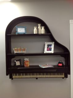 26 DIY Inventive Ideas how to Repurpose Old Pianos - as a wall shelf. Using the top only,  will make it much less heavy without the metal.