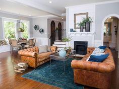 Living Room With Turquoise Velvet Rug Designed by Joanna Gaines   HGTV >> http://www.hgtv.com/design-blog/design/trending-now--transitioning-with-teal-?soc=pinterest