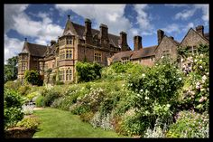 """Knightshayes Court, a Victorian country house in Tiverton, Devon, designed by William Burges for the Heathcoat-Amory family. Nikolaus Pevsner describes it as """"an eloquent expression of High Victorian ideals in a country house of moderate size."""" Grade I listed since 12.5.1975. Knightshayes Court has been in the ownership of the National Trust since 1973."""