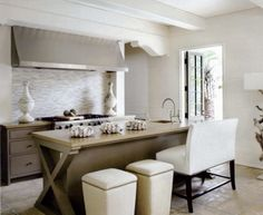 Amazing kitchen with white box beams, gray cabinets with gold countertops and linear gray glass tile backsplash, x-base gray kitchen island with sink lined with white kitchen island bench and ivory ottomans with nailhead trim. Beach House Kitchens, Cool Kitchens, New Kitchen, Kitchen Interior, Smart Kitchen, Design Kitchen, Kitchen Ideas, Kitchen Decor, Kitchen Island Bench
