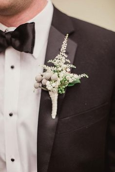 A boutonniere with brunia berry and astilbe | @shaunmenary | Brides.com