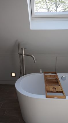 ensuite bathroom - locating the bath under the skylight allows for the reduced ceiling height to be a bonus feature Small Bathroom, Bathrooms, Ceiling Height, Skylight, Bath Caddy, Attic, Bathtub, Interior, Design